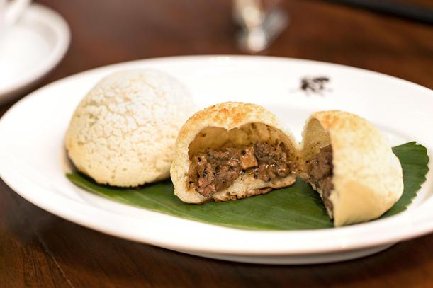 A baked Wagyu beef bun