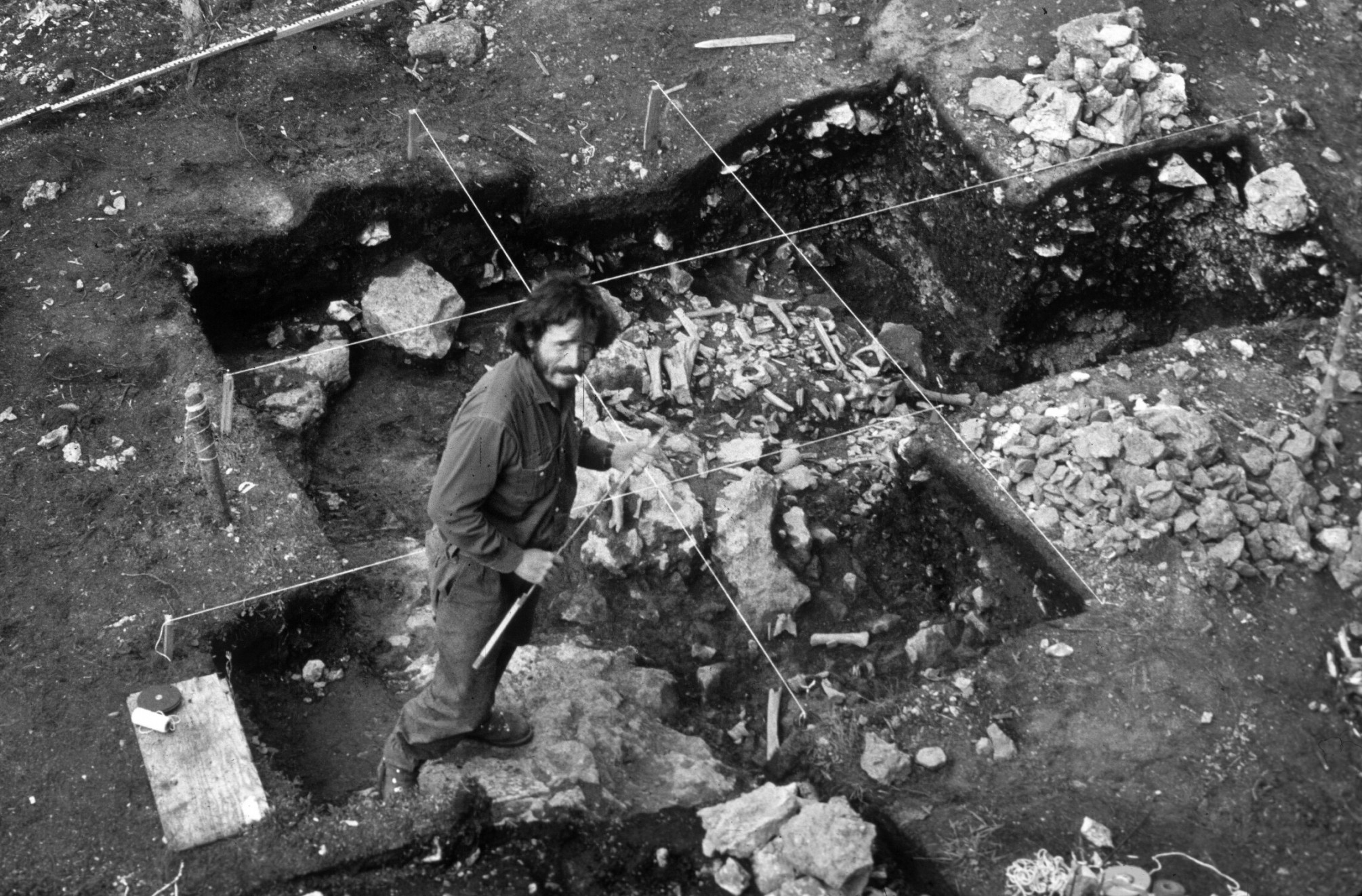 Archaeologist Cinq-Mars excavating at the Bluefish Caves in Yukon, Canada in the 1970s.