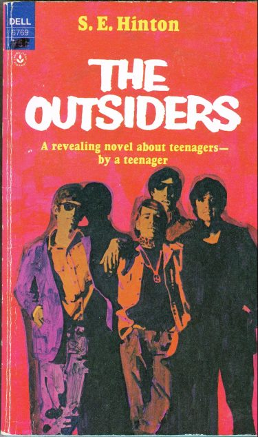 "The cover for the Laurel Leaf Library paperback edition of ""The Outsiders."""