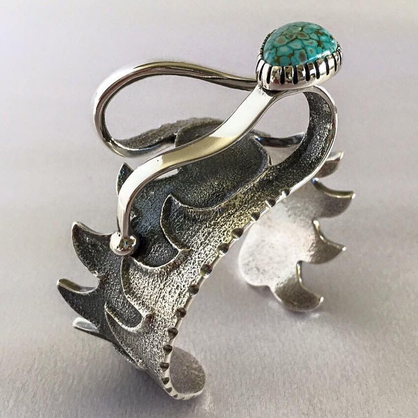 Silver jewelry by Monty Claw.