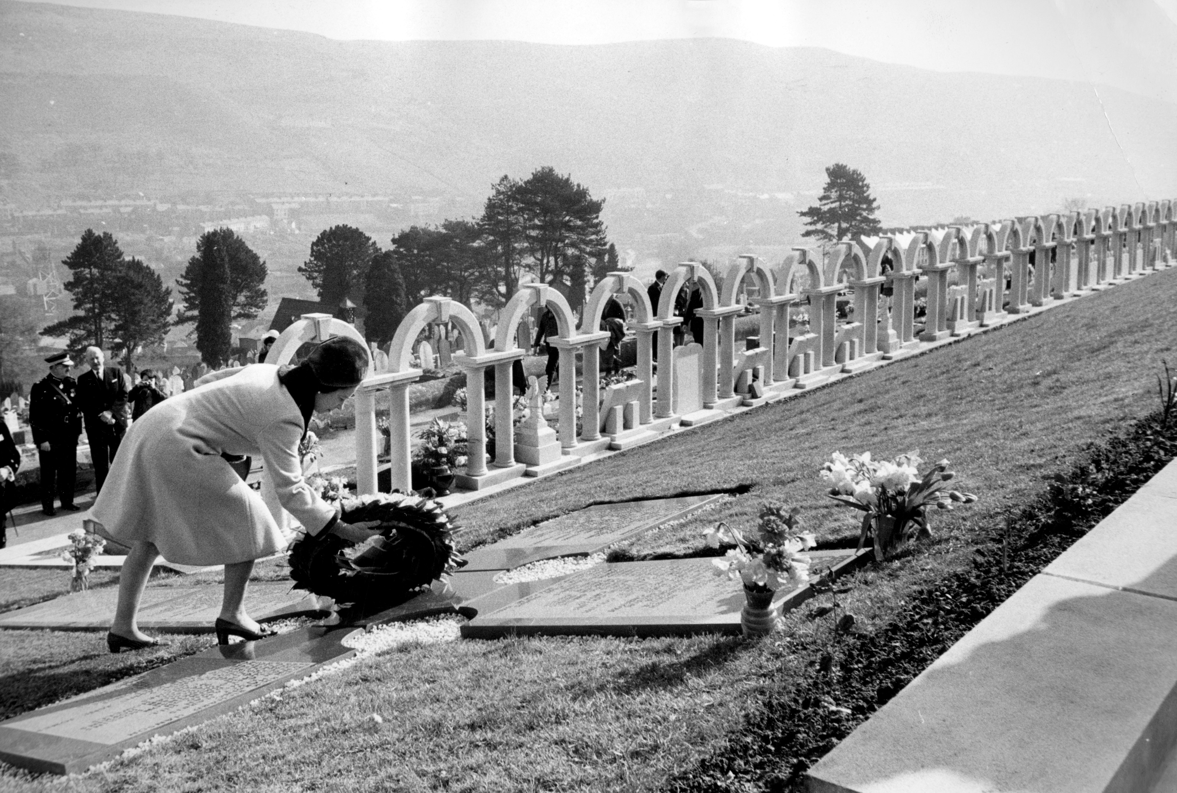Helpers fill sandbags on the tip above the shattered Pantglas Junior School to divert a spring and avert the risk of further landslides at Aberfan, South Wales.