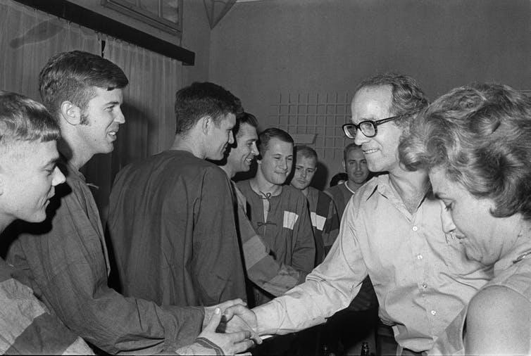 Coffin's activism: William Sloane Coffin Jr. greets captured American pilots in Hanoi, Vietnam.