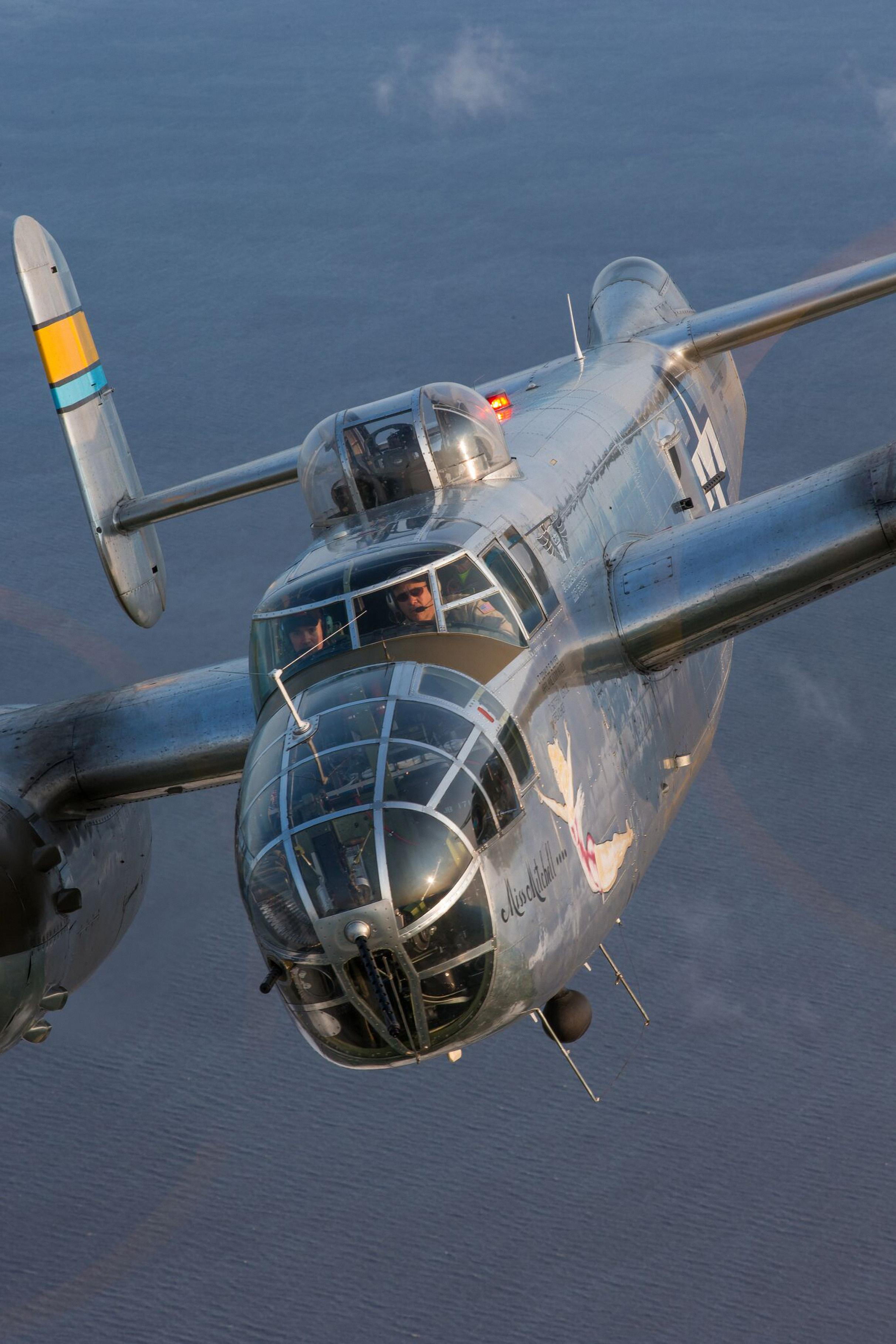 A Commemorative Air Force B-25 flies at Oshkosh in 2014.