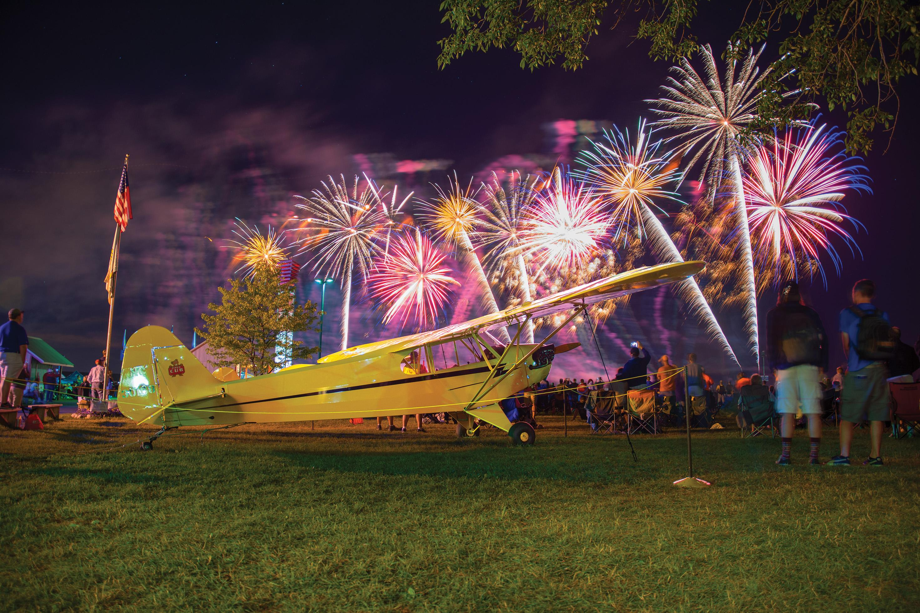"""""""Hooray for airplanes!"""" the fireworks finale at each evening of the AirVenture airshow seems to say. """"All are welcome,"""" from the biggest Air Force transport to the humblest Piper Cub."""