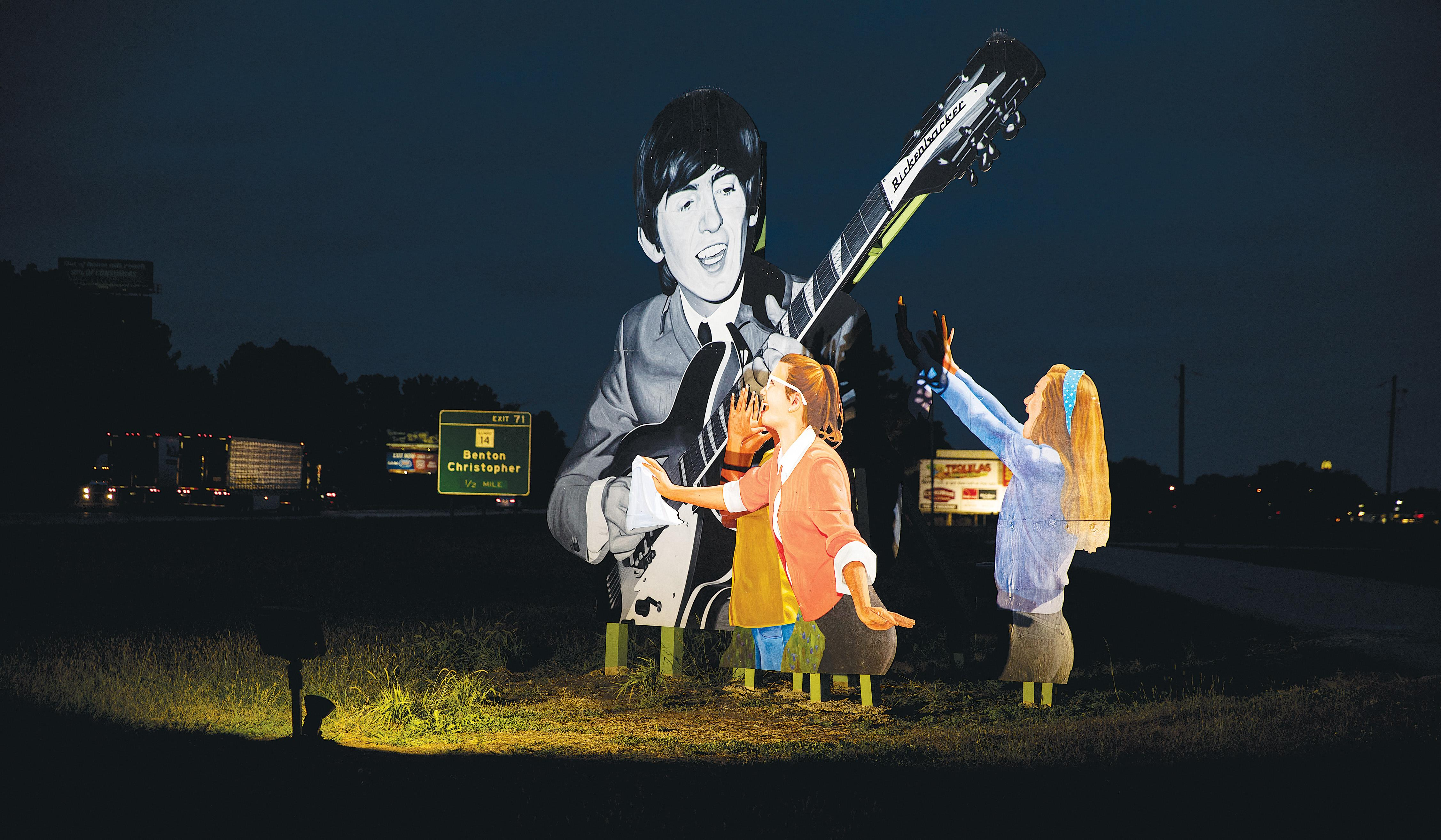 A billboard near Benton, Illinois. The rock 'n' roller from Liverpool was unknown in the States when he visited the town in 1963.