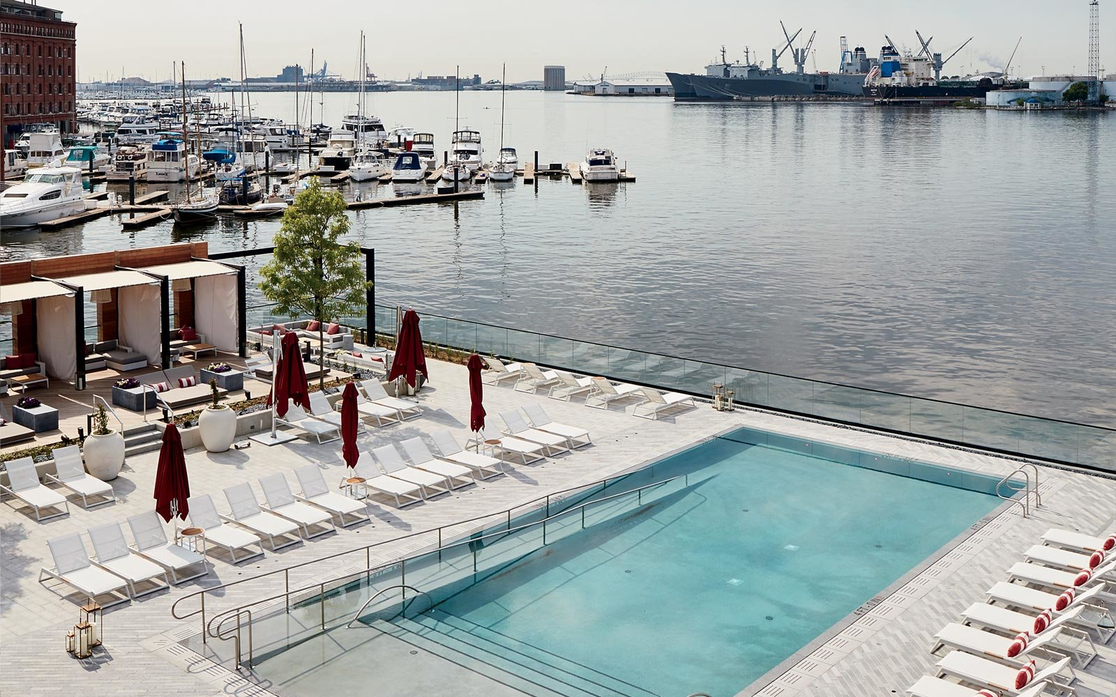 At the Sagamore Pendry Baltimore, the pool overlooks industry across the Patapsco River.