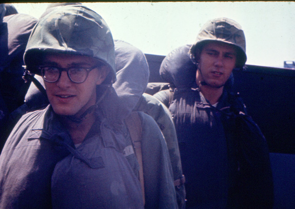 """""""In the Higgins boat heading towards the beach.  I'm the Marine on the right."""""""