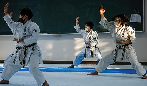 Yakumo Academy High School karate team members practice a kata. Competitors are judged on such things as strength, deportment and interpretation.