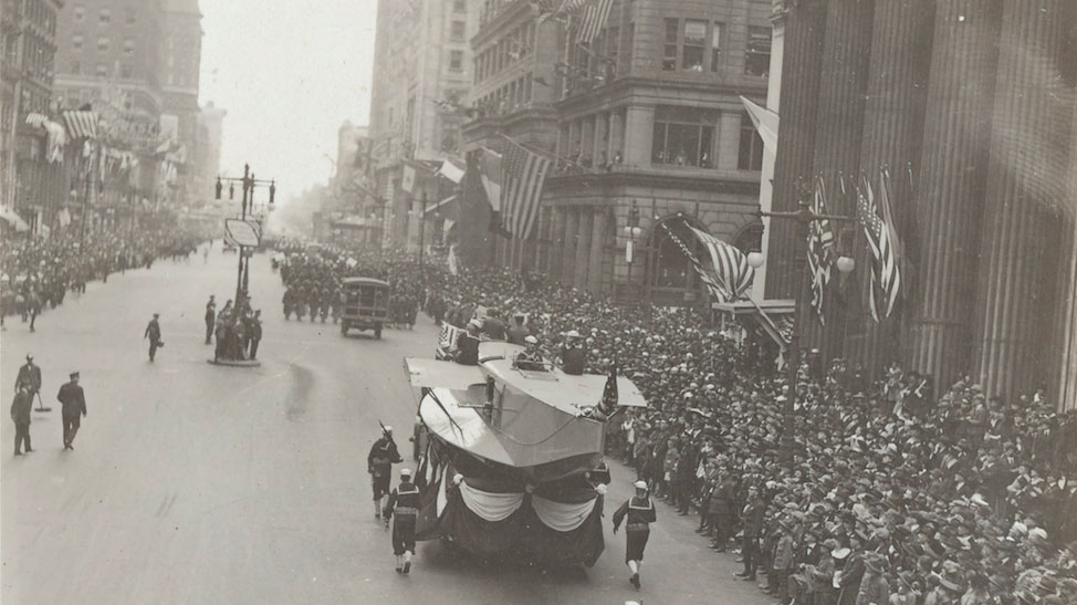 An aircraft hull travels the parade route in Philadelphia (U.S. Naval History and Heritage Command Photograph)