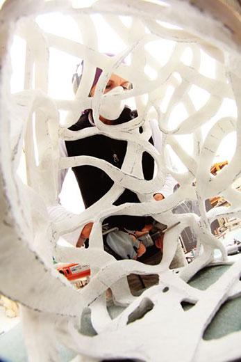 Turk works on a sculpture in her studio.