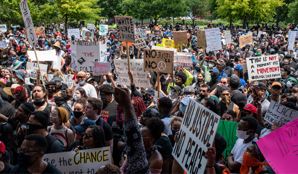 Protestors march through the streets of D.C. during demonstrations over the death of George Floyd, who died in police custody.