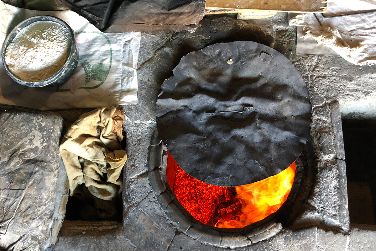 Before making lavash, the women of the bakery in Argel first let the fire burn down to allow for more even heat.