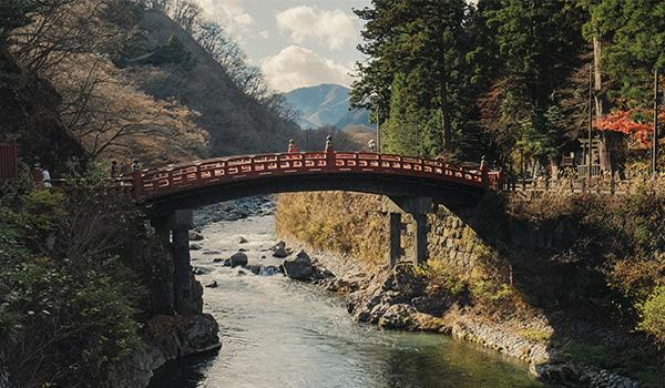 Spanning 92 feet across the Daiya River, the nearly 400-year-old Shinkyo Bridge serves as the sacred gateway to Nikko and the Toshogu Shrine complex.