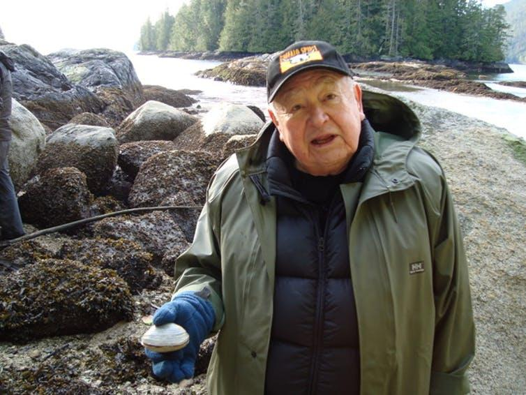 Kwaxsistalla Chief Adam Dick with a butter clam