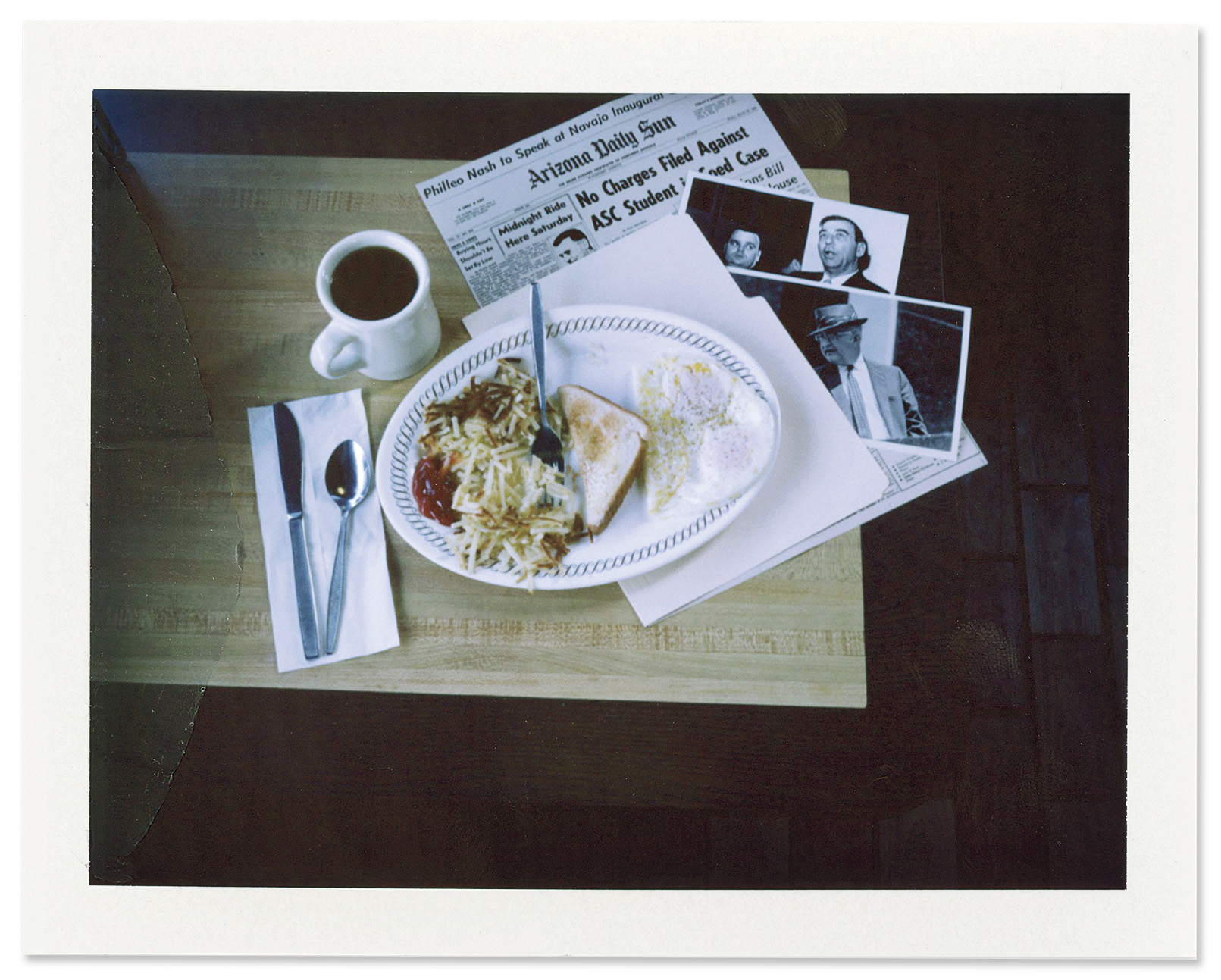 Old news stories and photographs of Billy James Hargis and Edwin Walker are laid out on a table at a Waffle House in Pelham, Alabama.