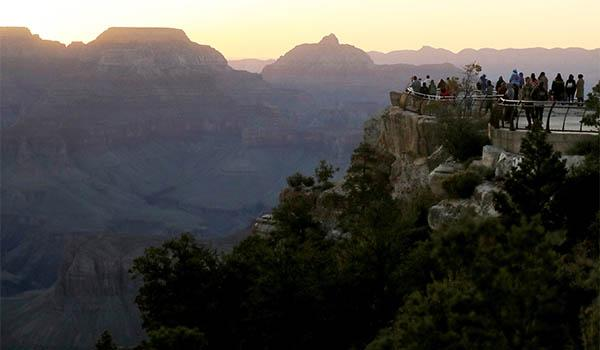 Visitors gather on the South Rim of Grand Canyon National Park after its reopening.