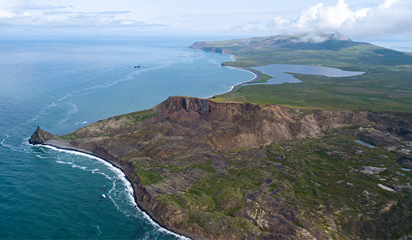 An aerial view of the northwestern corner of St. Matthew Island. The small grouping of uninhabited islands is over 300 kilometers across the Bering Sea from the mainland, making it the most remote location in Alaska.