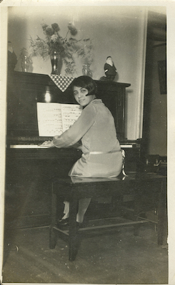Arias at the piano in her apartment in Brooklyn, circa 1925