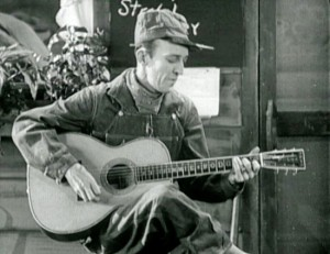 "Jimmie Rodgers sings ""Waiting for a Train"" in The Singing Brakeman."