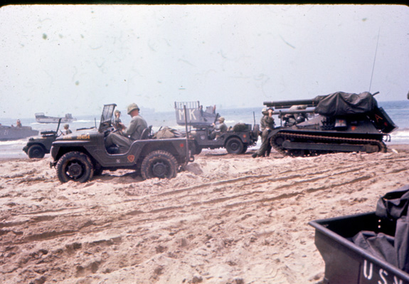 """""""Jeeps and tanks on the beach ready to 'attack.'"""""""
