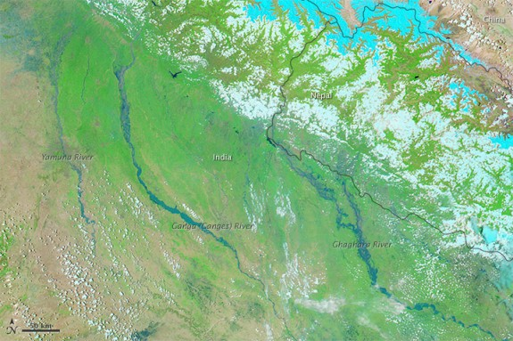 India's rivers swelled after the rains fell, causing widespread flooding, as seen in this photo from June 21.