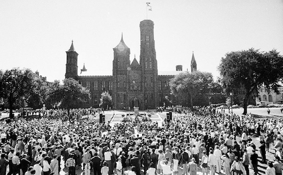 A crowd gathers to watch the installation of Secretary Adams in 1984