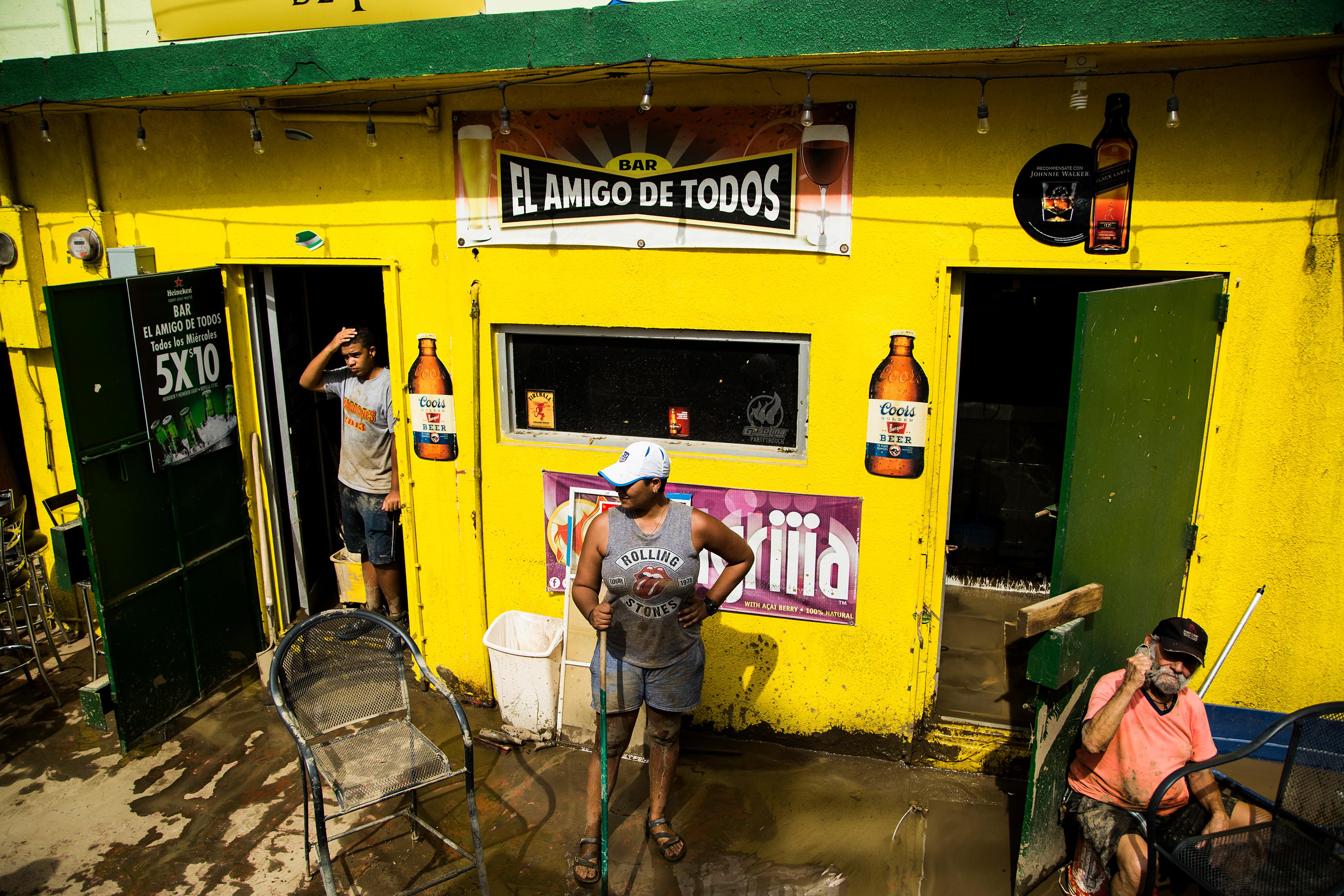 Workers clean a business that flooded in Toa Baja, on Puerto Rico's northern coast.