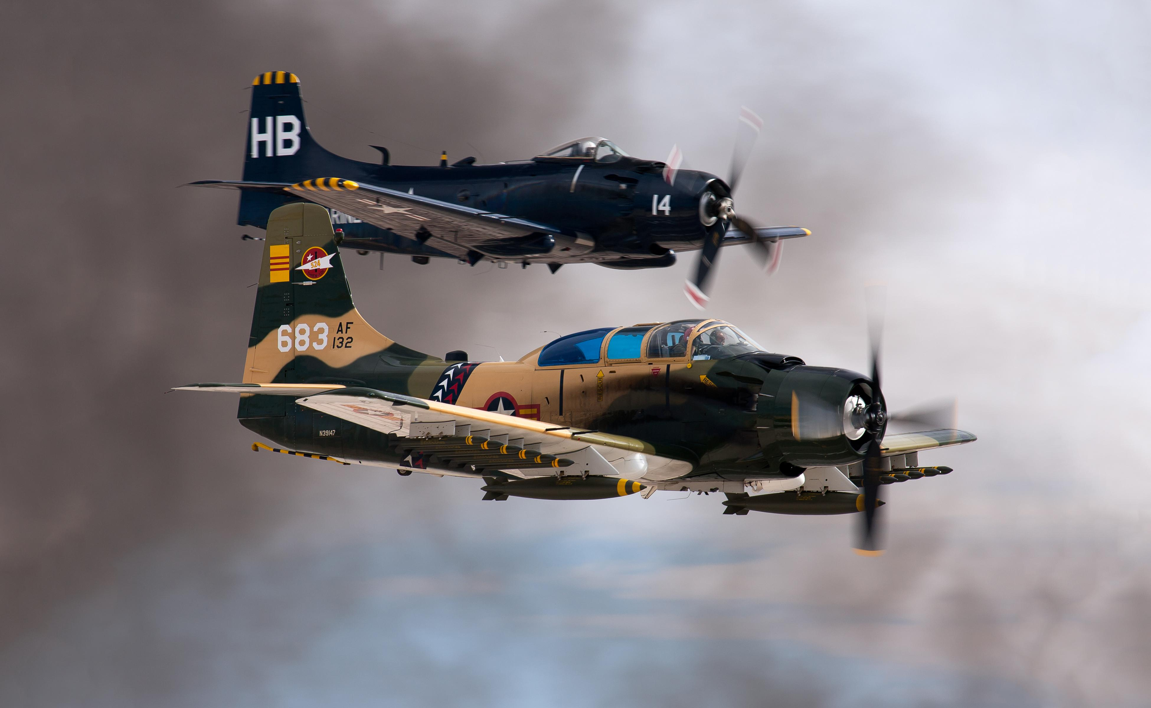 Skyraiders, more famous for attack missions than for ECM, fly fully loaded at a 2014 airshow.