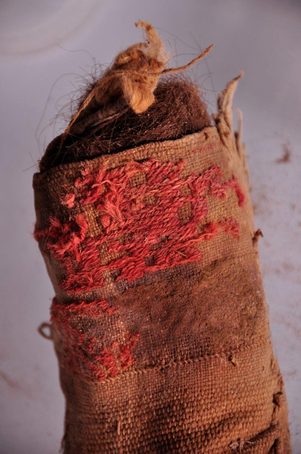 A woven cloth bag stuffed with human hair.