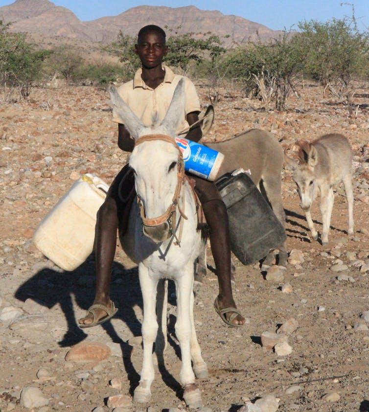 Water can be hard to access in rural areas. This young Namibian travels two miles round-trip every day to collect water for drinking, cooking and cleaning.