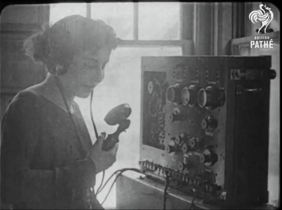 A woman speaking into a microphone