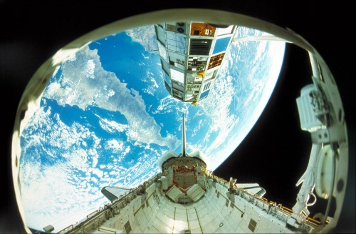 The view of Earth from inside a NASA space shuttle.