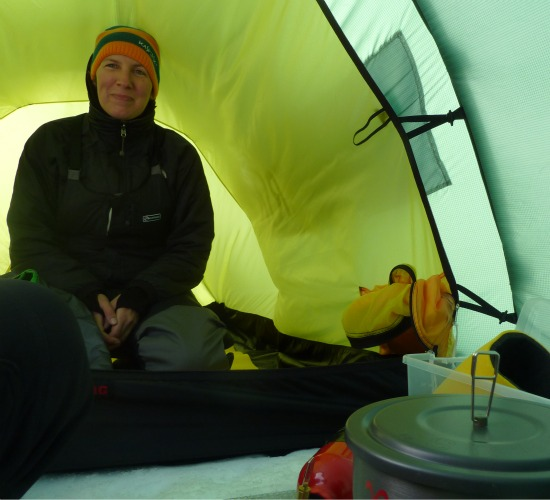 The cozy inside of Aston's tent, with dinner cooking in the foreground.