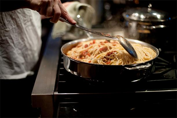 Spaghetti first began accompanying meat in Italian restaurants in America.