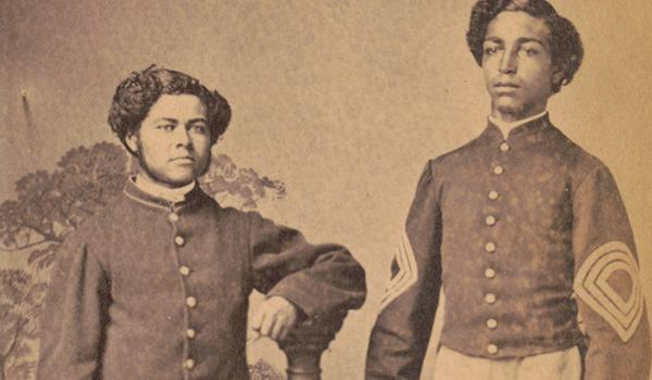 Sergeant Major William L. Henderson and hospital steward Thomas H.S. Pennington of the 20th U.S. Colored Troops Infantry Regiment, as photographed by W.H. Leeson