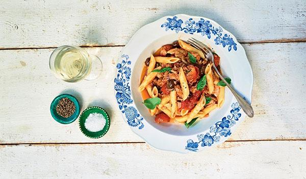 Pasta Puttanesca is one dish on our list that can be easily made in self-isolation with pantry ingredients like canned fish.